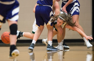 LINCOLN, NEB. - 02/16/2018 - Lincoln Pius X's Grace Driewer (center) dives through the legs of Grand Island's Kamryn Kier (left) and Sydney Wald (right) to get a loose ball Friday, Feb. 16, 2018, at Lincoln Pius X. KAYLA WOLF, Journal Star